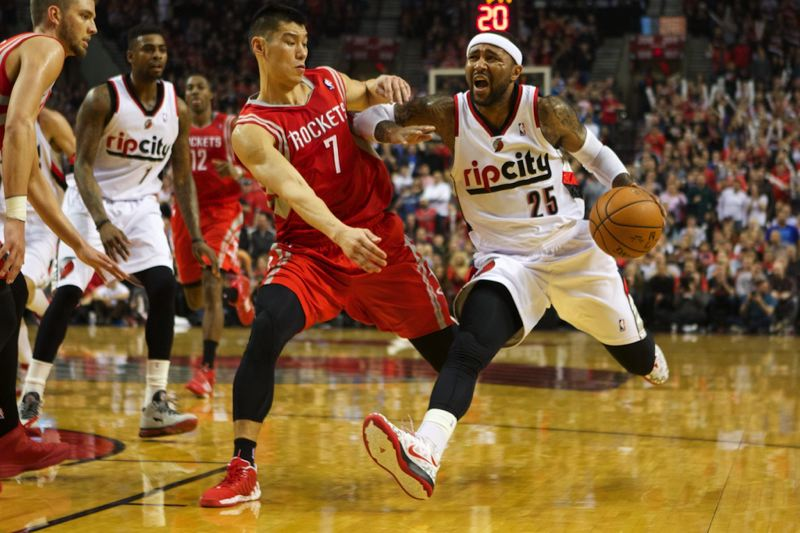 Mo Williams (right) drives against Houston's Jeremy Lin.