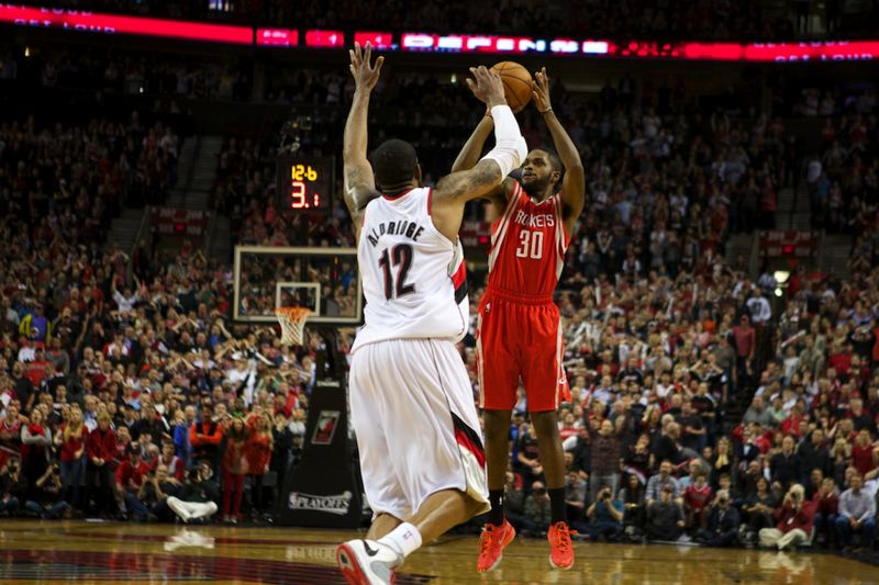 Troy Daniels shoots the winning 3-pointer late in overtime Friday night as the Houston Rockets defeat the Trail Blazers 121-116 at Moda Center