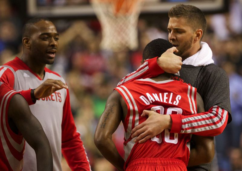 by: TRIBUNE PHOTO: JAIME VALDEZ - Troy Daniels gets a hug from Houston's Chandler Parsons and greetings from other Rockets after sinking the key 3-pointer late in overtime Friday against the Trail Blazers.