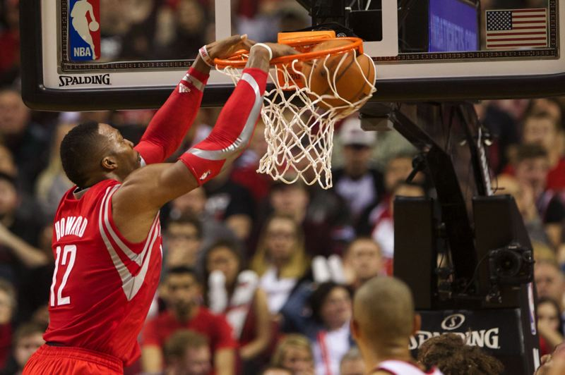 Houston Rockets center Dwight Howard dunks for two of his 24 points in Friday night's Game 3 at Moda Center.