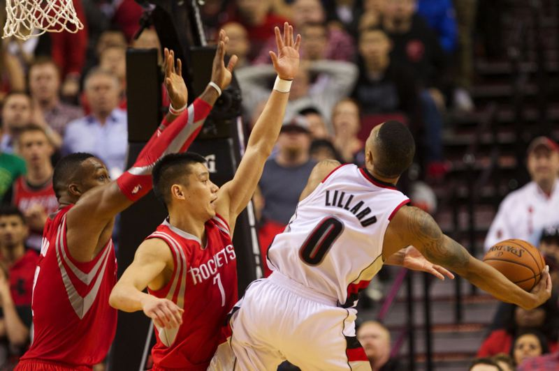 Trail Blazers guard Damian Lillard makes an acrobatic shot and is fouled late in the fourth quarter against the Rockets.