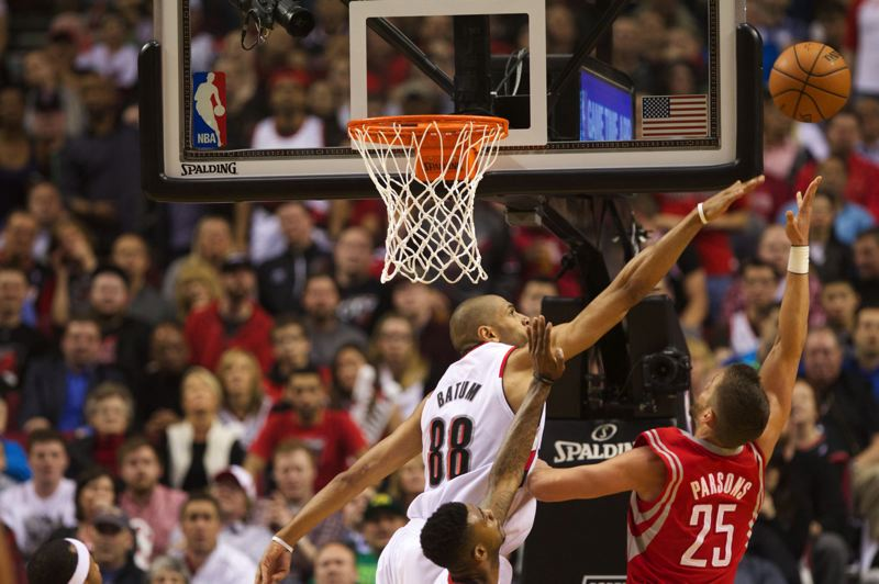 Blazers forward Nicolas Batum contests a shot by Houston's Chandler Parsons.