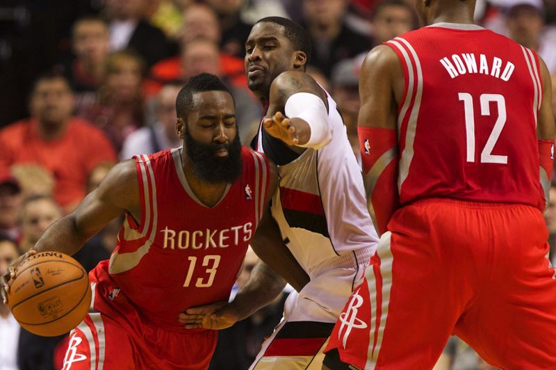 by: TRIBUNE PHOTO: JAIME VALDEZ - Trail Blazers guard Wesley Matthews fights through Dwight Howard's screen as he tries to stay with Houston Rockets guard James Harden during Game 3 of their NBA playoff series Friday night at Moda Center.