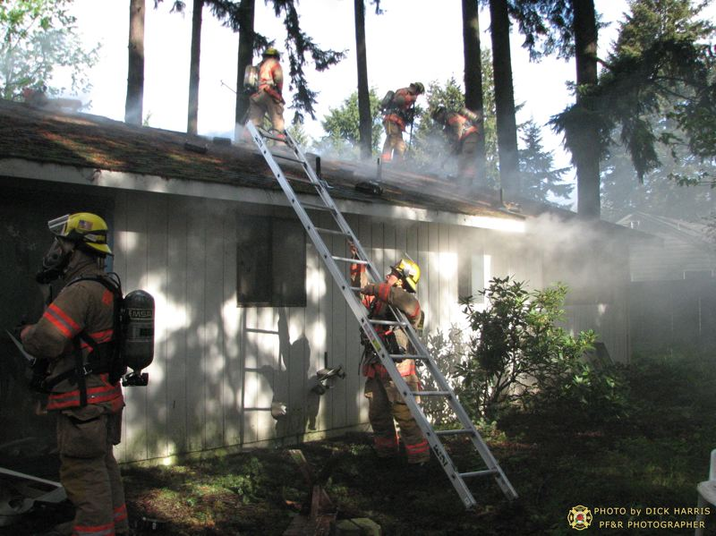 by: DICK HARRIS/ PORTLAND FIRE & RESCUE - Firefighters responded to this house fire in Southeast Portland on Sunday morning.