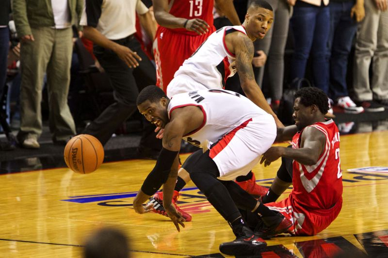 by: TRIBUNE PHOTO: JAIME VALDEZ - Trail Blazers guard Wesley Matthews knocks the ball away from Houston's Patrick Beverley in the final seconds of Portland's 123-120 overtime playoff victory Sunday at Moda Center.