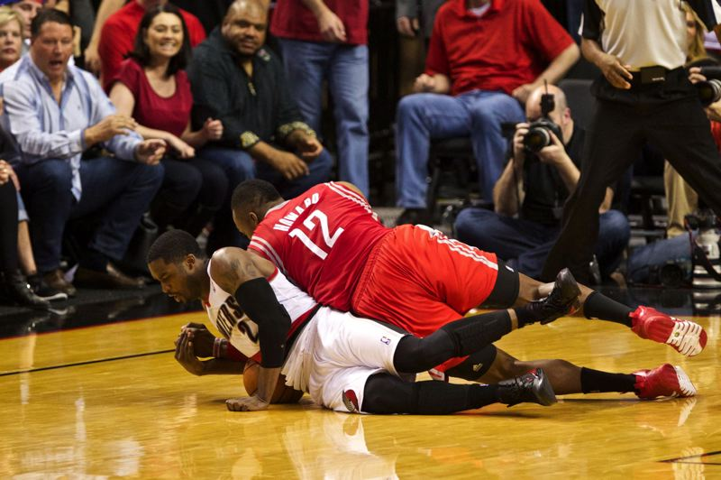by: TRIBUNE PHOTO: JAIME VALDEZ - Wesley Matthews wrestles the ball away from Houston center Dwight Howard during overtime Sunday, as Portland captures Game 4 of their NBA first-round playoff series 123-120 to take a 3-1 lead.