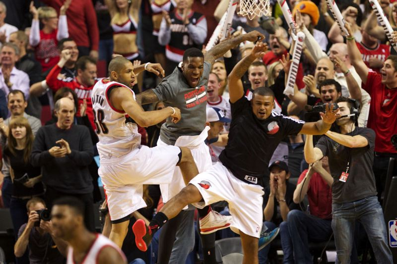 by: TRIBUNE PHOTO: JAIME VALDEZ - Nicolas Batum (left) celebrates with teammates after sinking a 3-pointer in overtime en route to the Trail Blazers' 123-120 victory Sunday over the Houston Rockets.