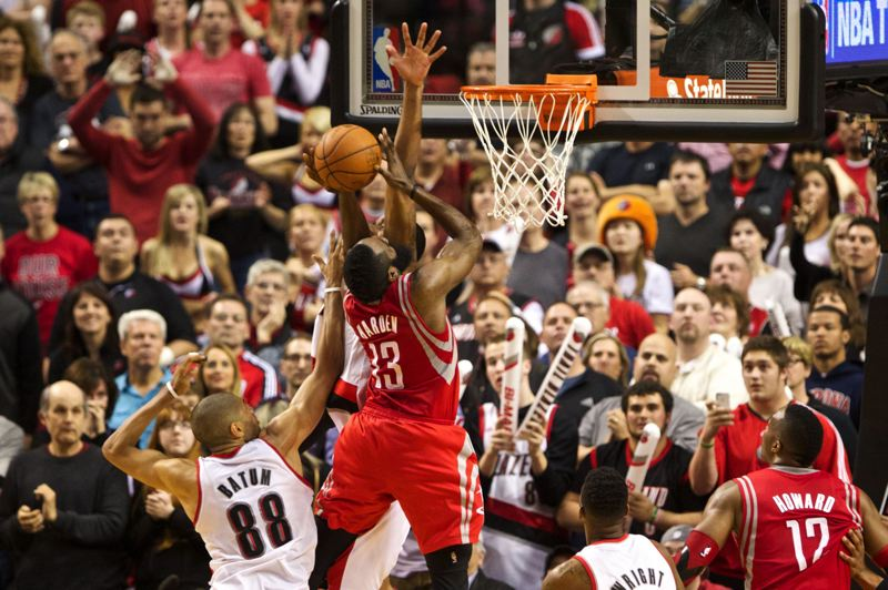 Nicolas Batum and LaMarcus Aldridge defend James Harden on an overtime drive.