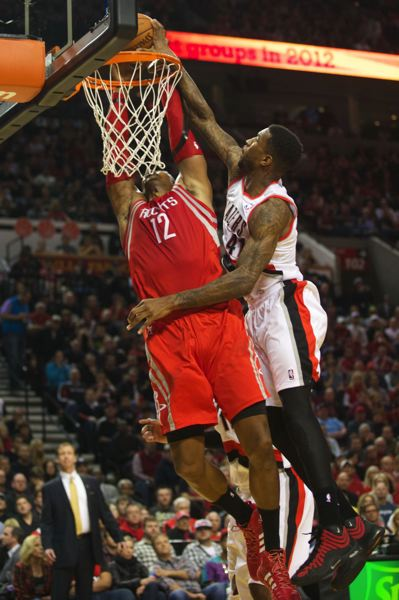 Thomas Robinson of the Blazers goes up to block Dwight Howard of the Rockets.