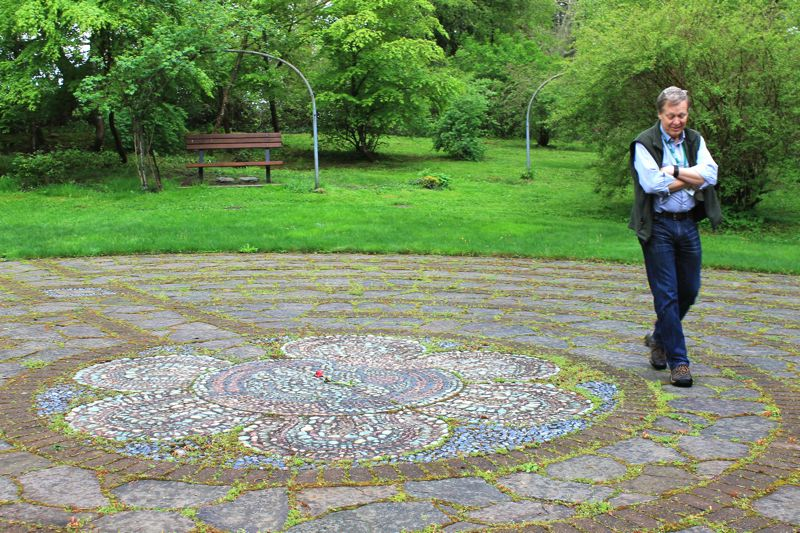by: OUTLOOK PHOTO: CARI HACHMANN - Meier's menora-shaped rose garden was replaced with a rock labyrinth. Walking the circular path, the Rev. Spencer Parks, Menucha executive director, says it's a tool for prayer and meditation.