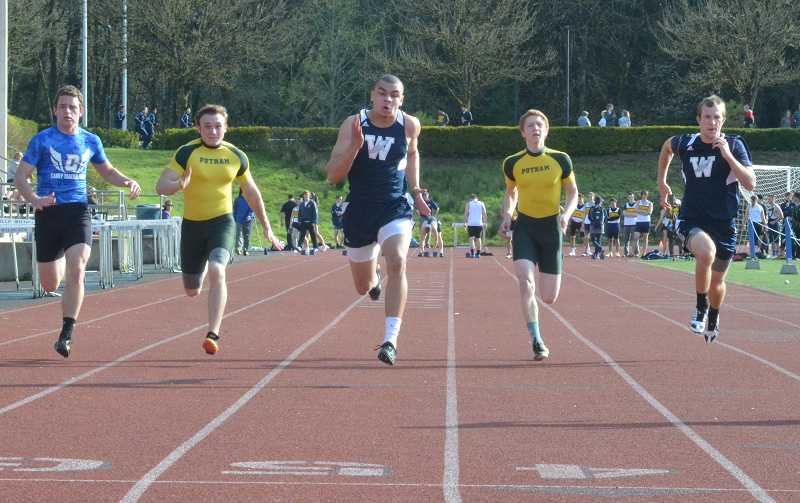 by: JEFF GOODMAN / PAMPLIN MEDIA GROUP - Micco Mills (center) has climbed into Wilsonville's all-time top 10 in the boys 100- and 200-meter dashes.