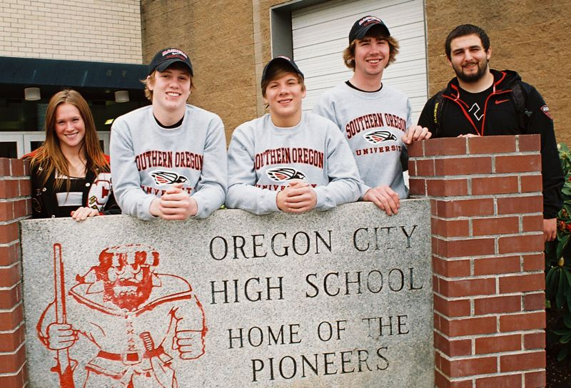 by: JOHN DENNY - Oregon City High School standout athletes (from left) Becca Houk, Devin Poppen, Kyle Sether, Tanner Fischer and Toni Corvi last Friday signed letters of intent to compete in sports in college. Houk inked with Seattle Pacific; Corvi inked with College of the Siskiyous; Poppen, Sether and Fischer will wrestle for Southern Oregon.