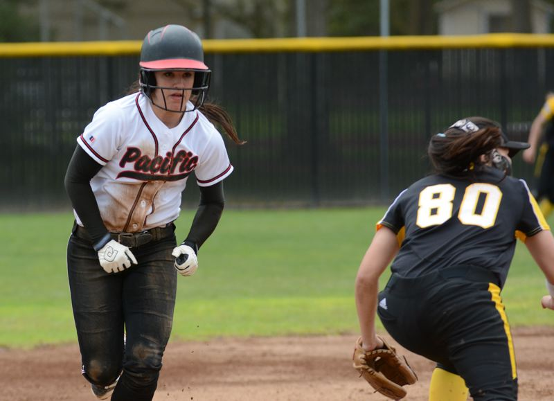 by: COURTESY PACIFIC UNIVERSITY - Rachel Roberts (left) finished her sophomore season of softball at Pacific University with a school record 47 stolen bases and a Northwest Conference-leading .468 batting average. The 47 stolen bases is the best in the nation for NCAA Division III for 2014.