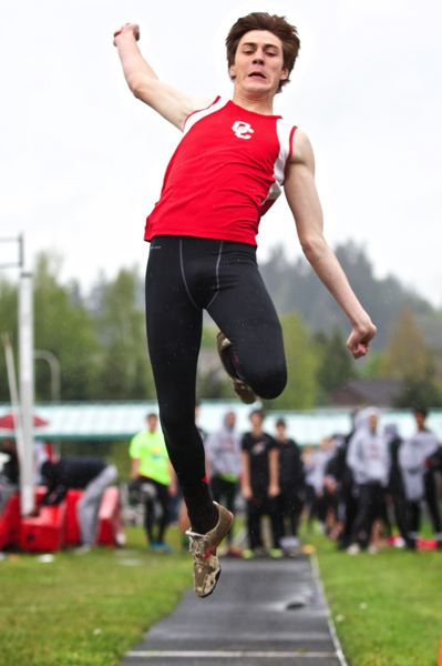 by: JAIME VALDEZ - Oregon City senior Alex Canchola cleared 6-0 for a win in the high jump and he leaped 20-4-1/4 to finish a close second to Clackamas senior Connor McLean in the long jump in last weeks dual meet with the Cavaliers.