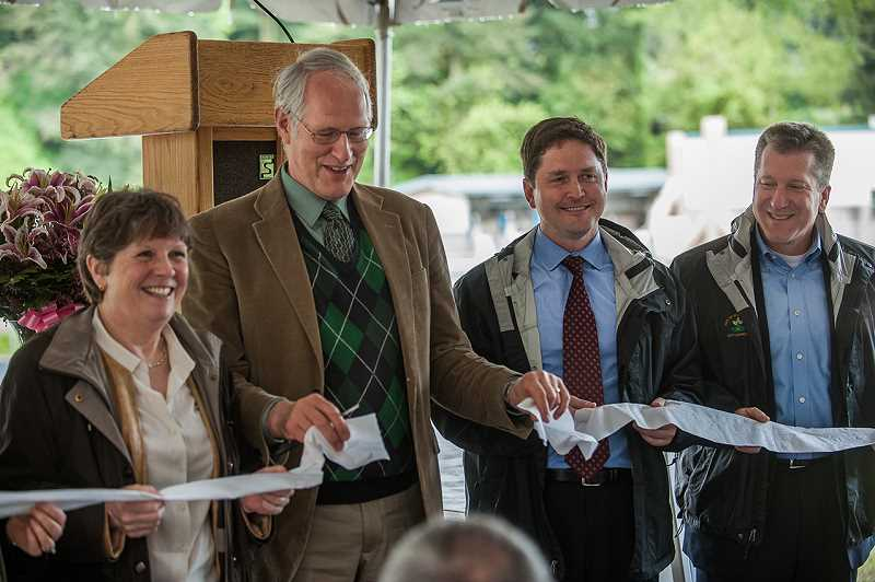 by: SPOKESMAN PHOTO: JOSH KULLA - Wilsonville city councilors (L-R, Susie Stevens, Mayor Tim Knapp, Richard Goddard and Scott Starr) cut the ribbon during the dedication of Wilsonvilles new wastewater plant.