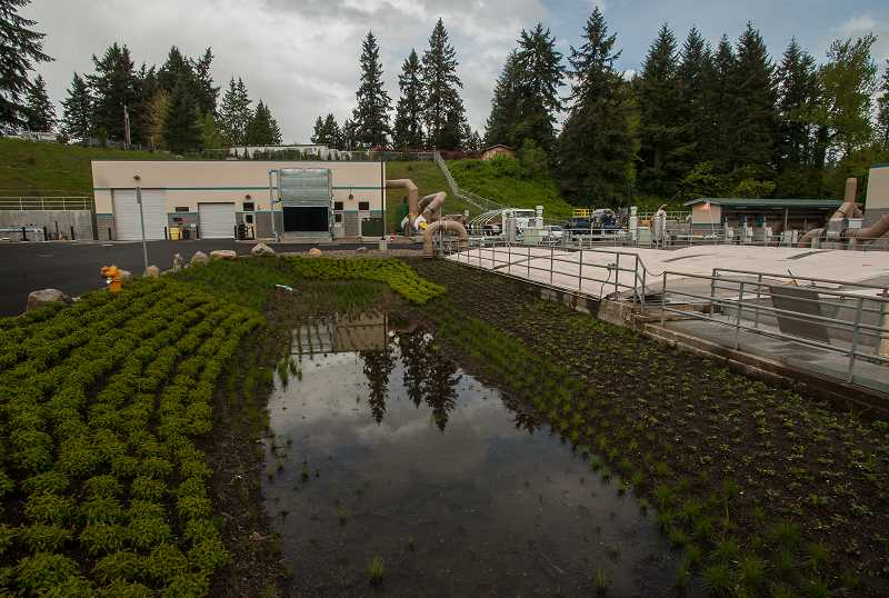 by: SPOKESMAN PHOTO: JOSH KULLA - The new drying and dewatering building shown at left is one of two brand new structures built as part of Wilsonville's new wastewater treatment plant.