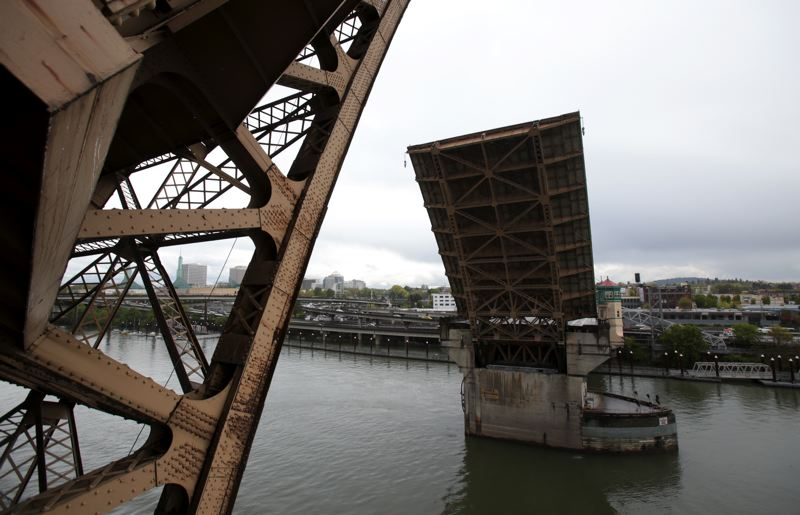by: TRIBUNE PHOTO: JONATHAN HOUSE - The 88-year-old Burnside Bridge slowly closes after a test lift last week. The county recently spent about $9 million on repairs to the bridge.