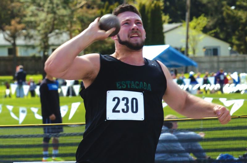 by: ESTACADA NEWS: PARKER LEE - Estacada senior Justin Rich lets loose with a throw on his way to a fifth-place finish in the event at the Centennial Invitational.