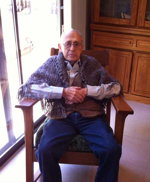 by: SUBMITTED PHOTO - Roscoe Ball, 94, enjoys his cozy prayer shawl, made for him by members of Willamette United Methodist Church in West Linn.