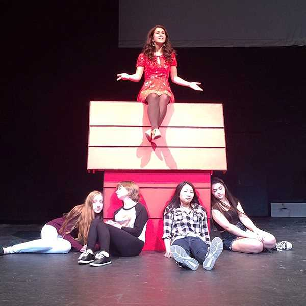 by: SUBMITTED PHOTOS - Snoopy, played by Olivia Klugman, serenades the audience from the top of his doghouse, while the Woodstocks snooze. The Woodstocks, from left, are played by Izzy Ochocki, Deidre Fitzgerald, Kylee Kamakawa and Jordan Jaffe.