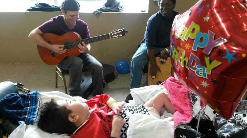 by: SUBMITTED - The Gutierrez twins' birthday party featured a personal performance by the Portland band Hit Machine (pictured) and a 'just-for-fun' ride in an ambulance, thanks to American Medical Response.