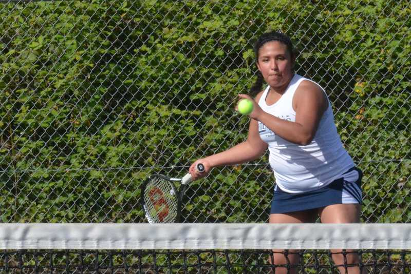 by: JEFF GOODMAN / PAMPLIN MEDIA GROUP - Carolina Ramirez-Islas lines up a forehand shot on the No. 3 singles court during the Wilsonville girls tennis team's 6-3 win over Sandy at home April 29. Ramirez-Islas defeated Taylor Courtain 6-4, 6-1.