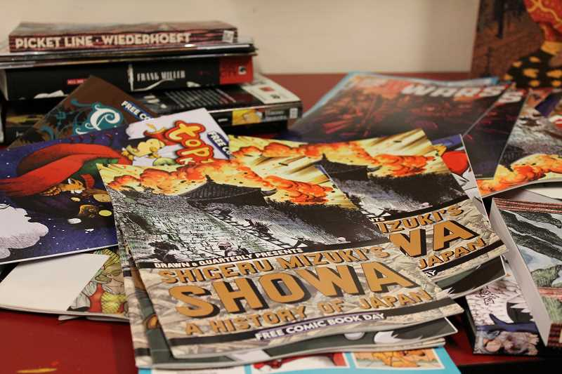 by: TIDINGS PHOTO: PATRICK MALEE - The library will hand out more than 300 free comic books geared toward readers of all ages, and a raffle will also feature special prizes.