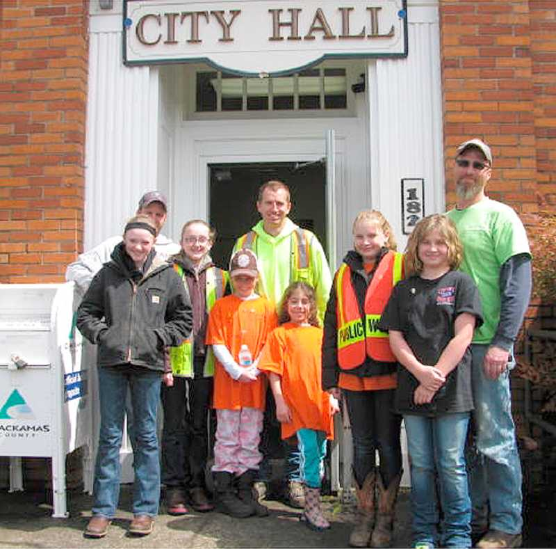 by: CITY OF CANBY - On Take Your Children to Work Day, a trio of daughters joined their dads at the City of Canby. (Front row) They are Emma and Grace Nelzen; Ashley and Shelby Goetz and Kiley and Kennedy Hester. (Back row) is Jerry Nelzen, Chris Goetz and Shane Hester.