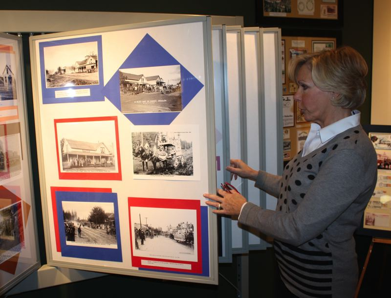by: POST PHOTO: KYLIE WRAY - Hoffman puts her journalistic skills to work assembling historical photos into the societys Discover Sandy booklet. Many of the photos are displayed in the museum.