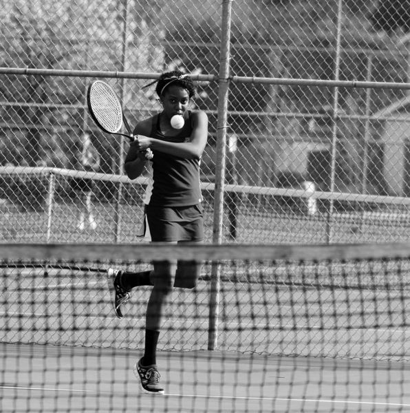by: NEWS-TIMES PHOTO: AMANDA MILES - Forest Grove junior Karimi Nyamu hits a backhand during a home tennis match last Thursday.