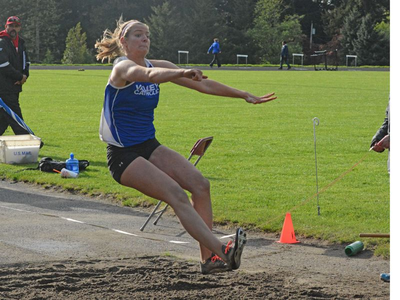 by: TIMES PHOTO: MATT SINGLEDECKER - Valley Catholic junior Ella Turkot won three events on Thursday including the triple jump versus her old school Catlin Gabel on Thursday.