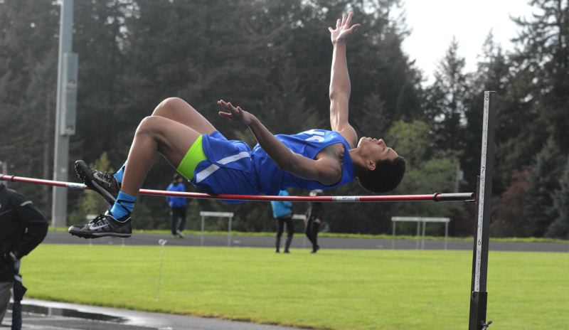 by: TIMES PHOTO: MATT SINGLEDECKER - Valley Catholic freshman Daniel Hardy finished third in the high jump against Catlin Gabel, clearing 5-04.