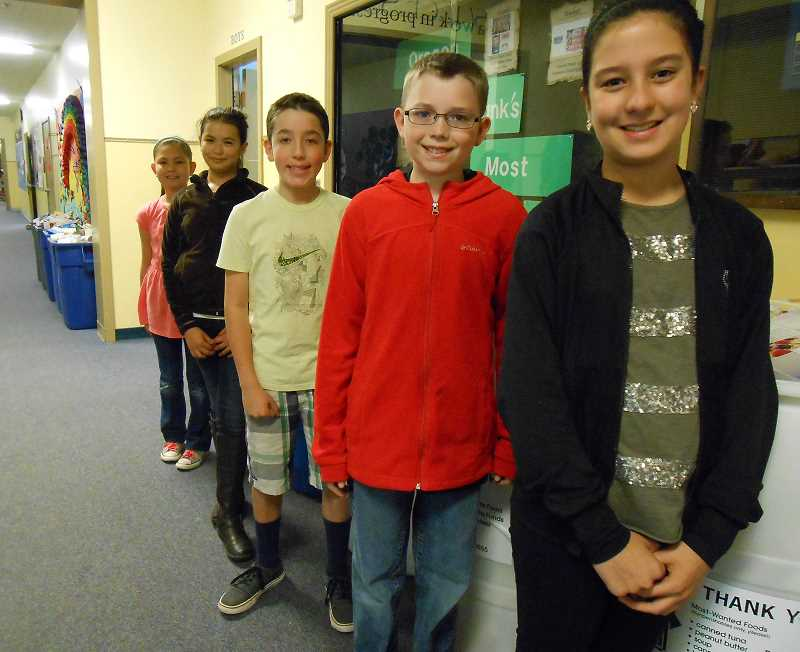 by: REVIEW PHOTO: JILLIAN DALEY - Many Lake Grove fifth-graders helped with a food drive, including , from left, Mimi Jeandheur, Briana Gutierrez, Jacob Matlock, Dustin Bittner and Natalia Schessl.