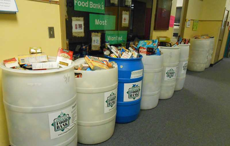 by: REVIEW PHOTO: JILLIAN DALEY - Lake Grove students filled several barrels with food for Oregon Food Bank.