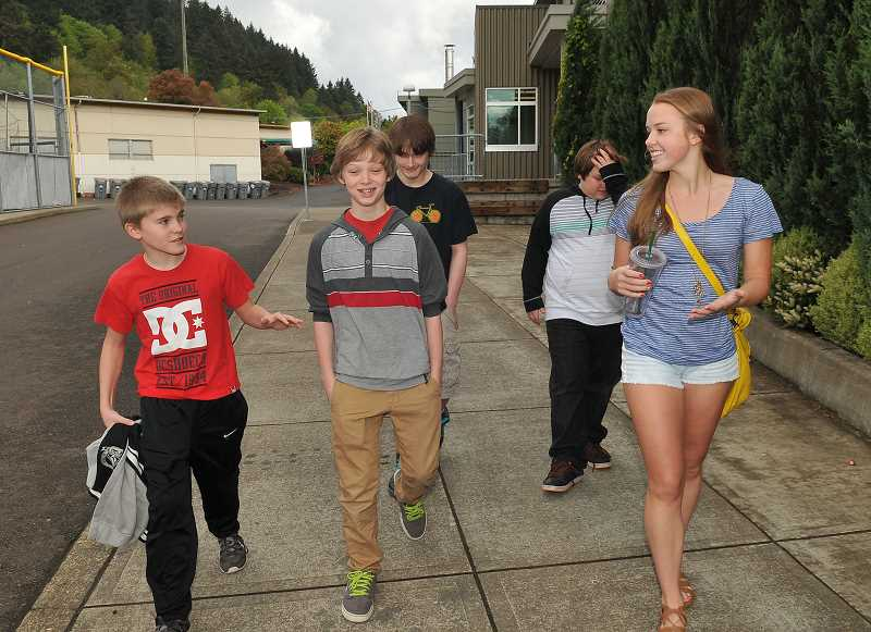 by: TIDINGS PHOTO: VERN UYETAKE - Senior Madison Mills, right, leads, from left, in-coming ninth graders Lake Shovoly, Cameron Croissant, Ben Leslie and Max Long on a tour of WLHS.