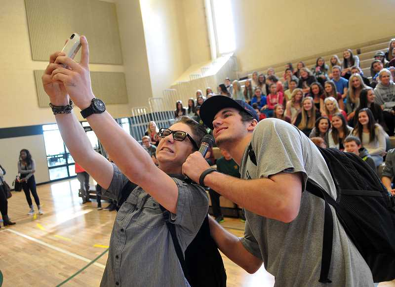 by: TIDINGS PHOTO: VERN UYETAKE - Travis Fain, left, and Kevin Edward take a selfie with the incoming ninth grade group.