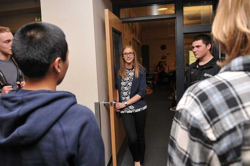 by: TIDINGS PHOTO: VERN UYETAKE - Math instructor Teale Lacolucci chats with a group of incoming frosh.