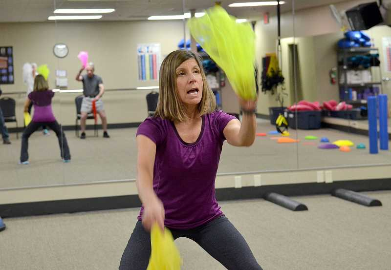 by: REVIEW PHOTO: VERN UYETAKE - Nancy Nelson doesnt take it easy on her exercise class students. But she has a way of bringing out their best efforts.