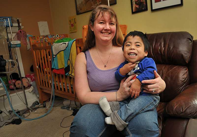 by: REVIEW PHOTO: VERN UYETAKE - Kerri Markley and her foster son Juan Castro are getting ready for the weekend of May 9-10, when people will be flocking to a fundraiser for Juans medical trip to San Diego.