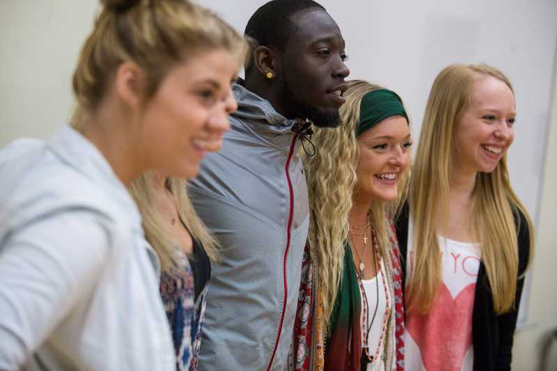 by: TIMES PHOTO: JONATHAN HOUSE  - De'Anthony Thomas takes pictures with Beaverton High School students during an appearance on Monday.
