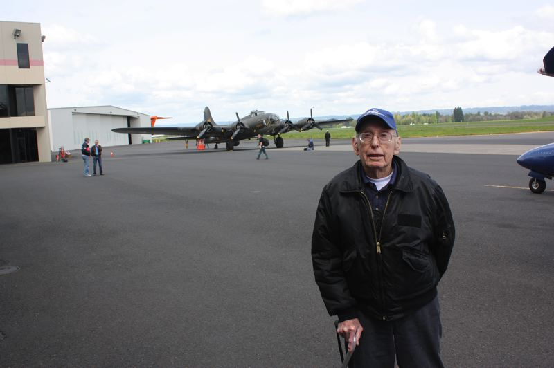 by: HILLSBORO TRIBUNE PHOTO: DOUG BURKHARDT - On Monday, Hillsboro resident James Miller, 91, took a flight on a B-17 like the one he served in as a 21-year-old tail gunner in World War II. Millers aircraft was shot down in 1944 and he spent nearly a year in a German prison camp.