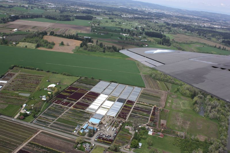 by: HILLSBORO TRIBUNE PHOTO: DOUG BURKHARDT - The Washington County landscape stretches out below the Memphis Belle during a Monday flight.