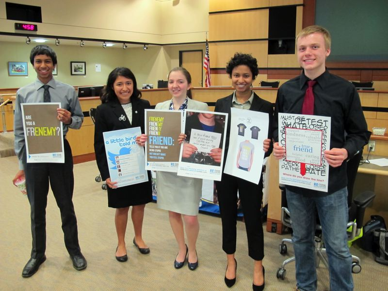 by: HILLSBORO TRIBUNE PHOTO: KATHY FULLER - Left to right, Ashwin Datta, Shirley Araiza, Lorena Colcer, Anisha Datta and Jonathan Napier, all students at Glencoe High School, are members of the Mayors Youth Advisory Council. They hold posters the YAC designed as a part of an anti-bullying campaign for the Hillsboro School District.