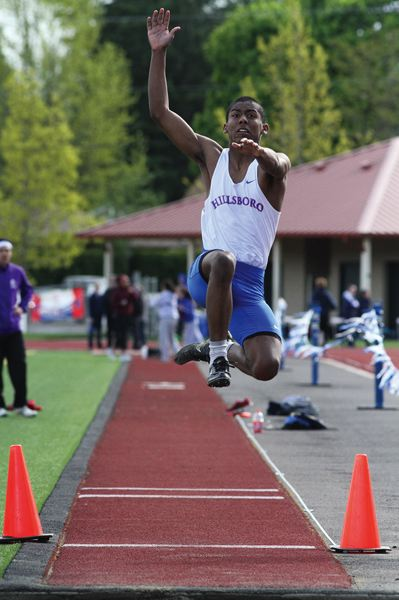 by: HILLSBORO TRIBUNE PHOTO: AMANDA MILES - Hilhi's Michael Gonzalez soars to a first-place finish in the triple jump last Friday.