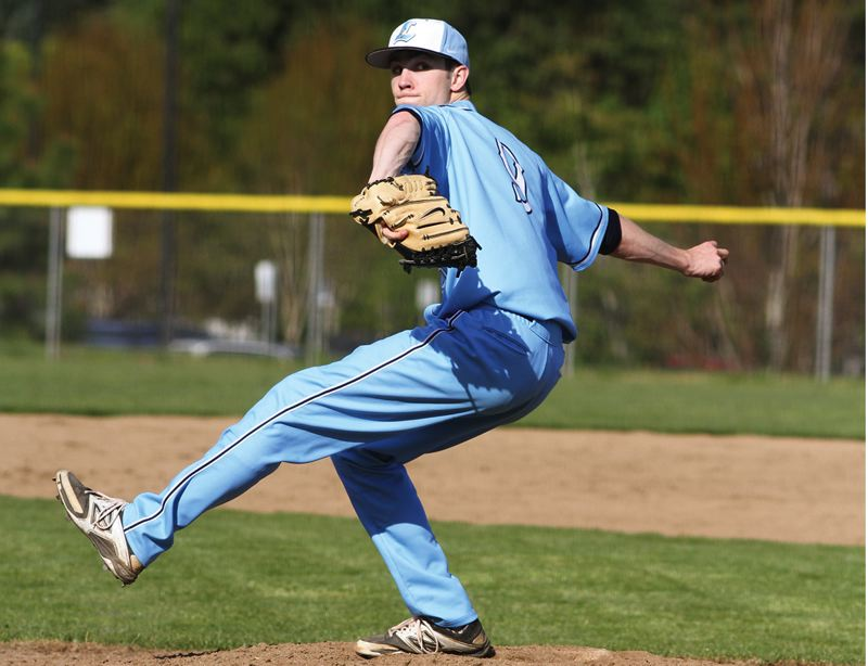 by: HILLSBORO TRIBUNE PHOTO: AMANDA MILES - Liberty junior Ryan Kaser winds up to deliver a pitch during Tuesday's Northwest Oregon Conference baseball game against Sherwood.