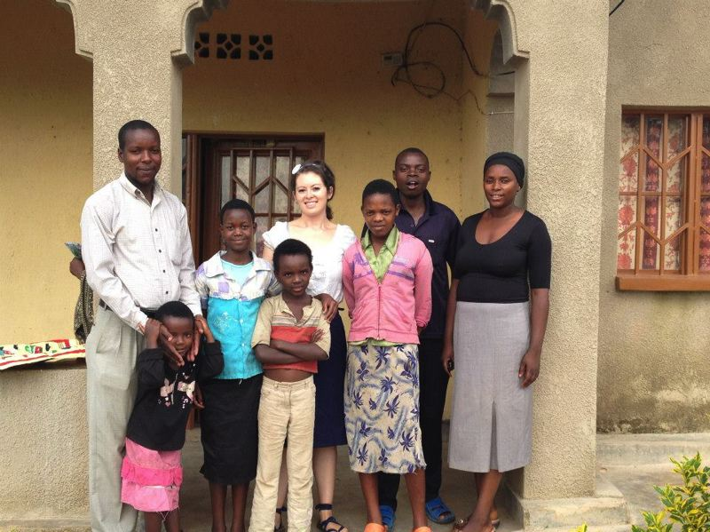 by: PHOTO COURTESY OF JENNIFER HATTON - Jennifer Hatton with her host family in the Gashora Sector of Rwanda.