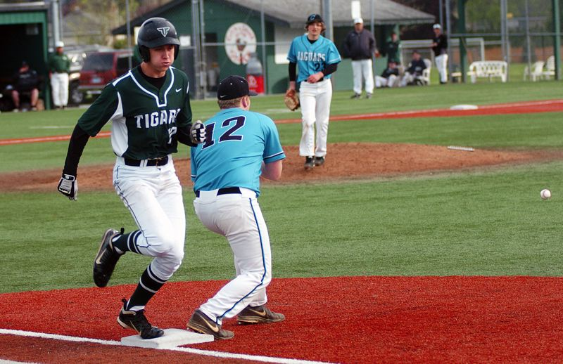 by: DAN BROOD - BEATING THE THROW -- Tigard senior Ray Barlow gets to first base before the ball in last week's Tiger win over Century.