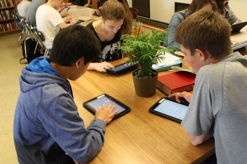by: SPOTLIGHT PHOTO: ROBIN JOHNSON - Scappoose High School Students (from left) Nathaniel Nguien, Megan Hadden and Owen Parsons use the schools new Nexus 10 tablets to study Shakespeares Hamlet through a psycho-analytical lens.