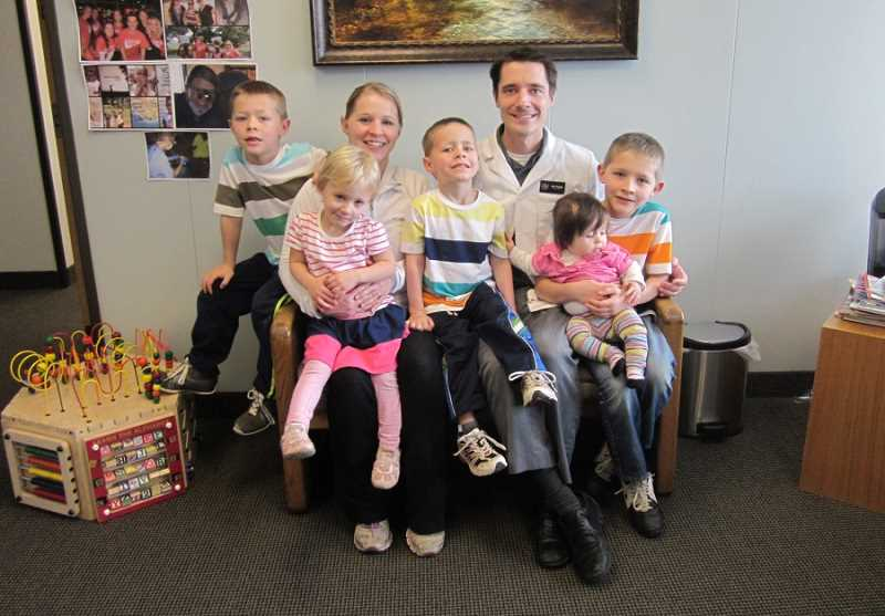 by: BARBARA SHERMAN - VISITING DAD AT WORK - Amanda and Joe Young's growing family includes (from left) Matthew, 7, Rebekah, 3, Jacob, 5, Elisabeth, 9 months, and Benjamin, 9.