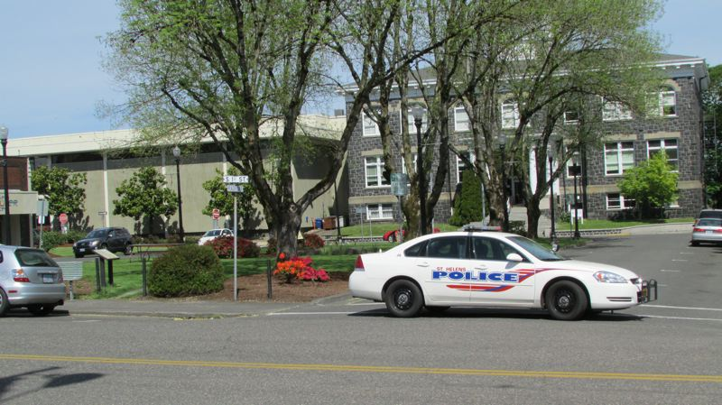 by: MARK MILLER - A St. Helens police cruiser blocks off Plaza Square from South First Street in St. Helens Thursday, May 1, after the Columbia County Courthouse was evacuated due to a bomb threat.